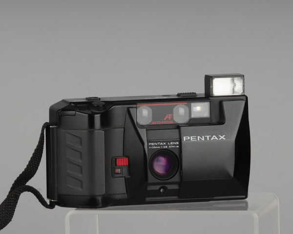 The Pentax PC35AF-M SE 35mm film point-and-shoot camera from the 1980s