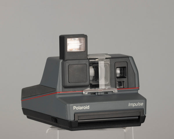 Polaroid Impulse instant camera with original case, prism lens filter, box, and manual