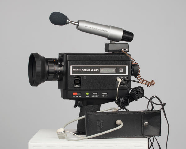 Sankyo Sound XL-60S super 8 camera shown with many accessories