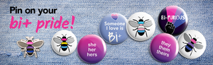 various bi, pan and trans buttons and pins on a denim background