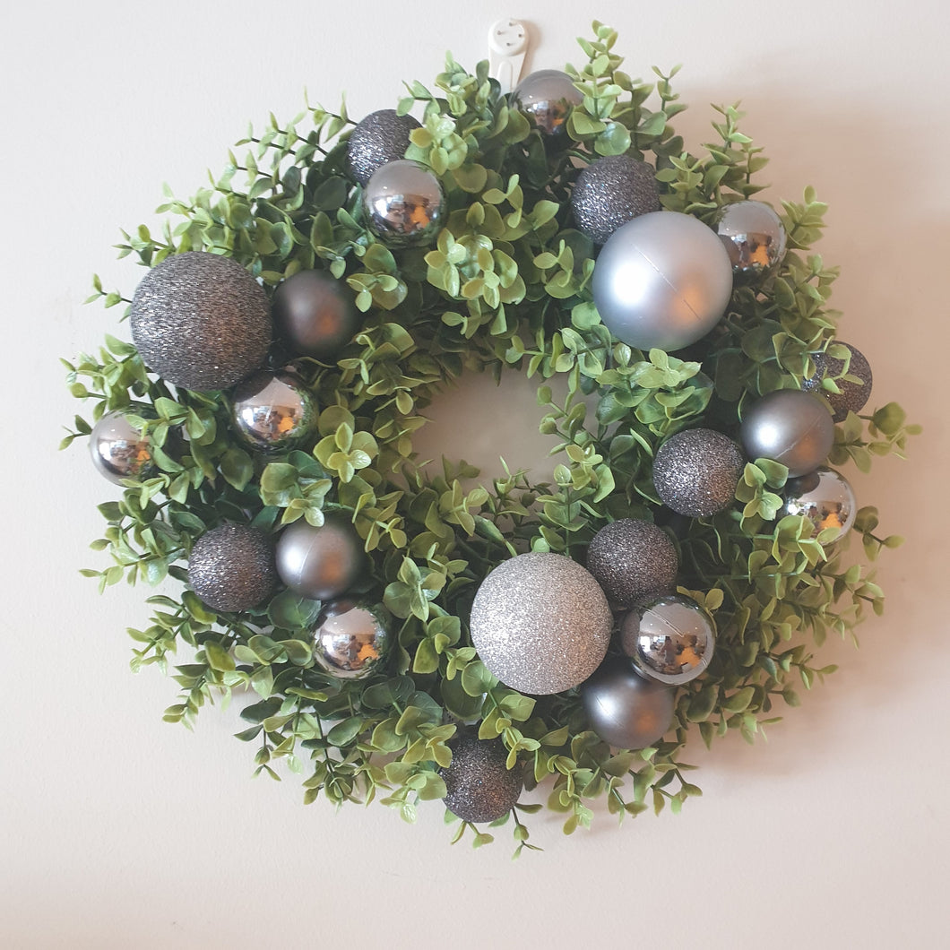 Black baubles and boxwood Christmas Wreath