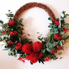 Load image into Gallery viewer, Australian Native large Red Banksia, and Red Pincushion protea with flowering gum bush foliage 60cm wreath - FREE DELIVERY