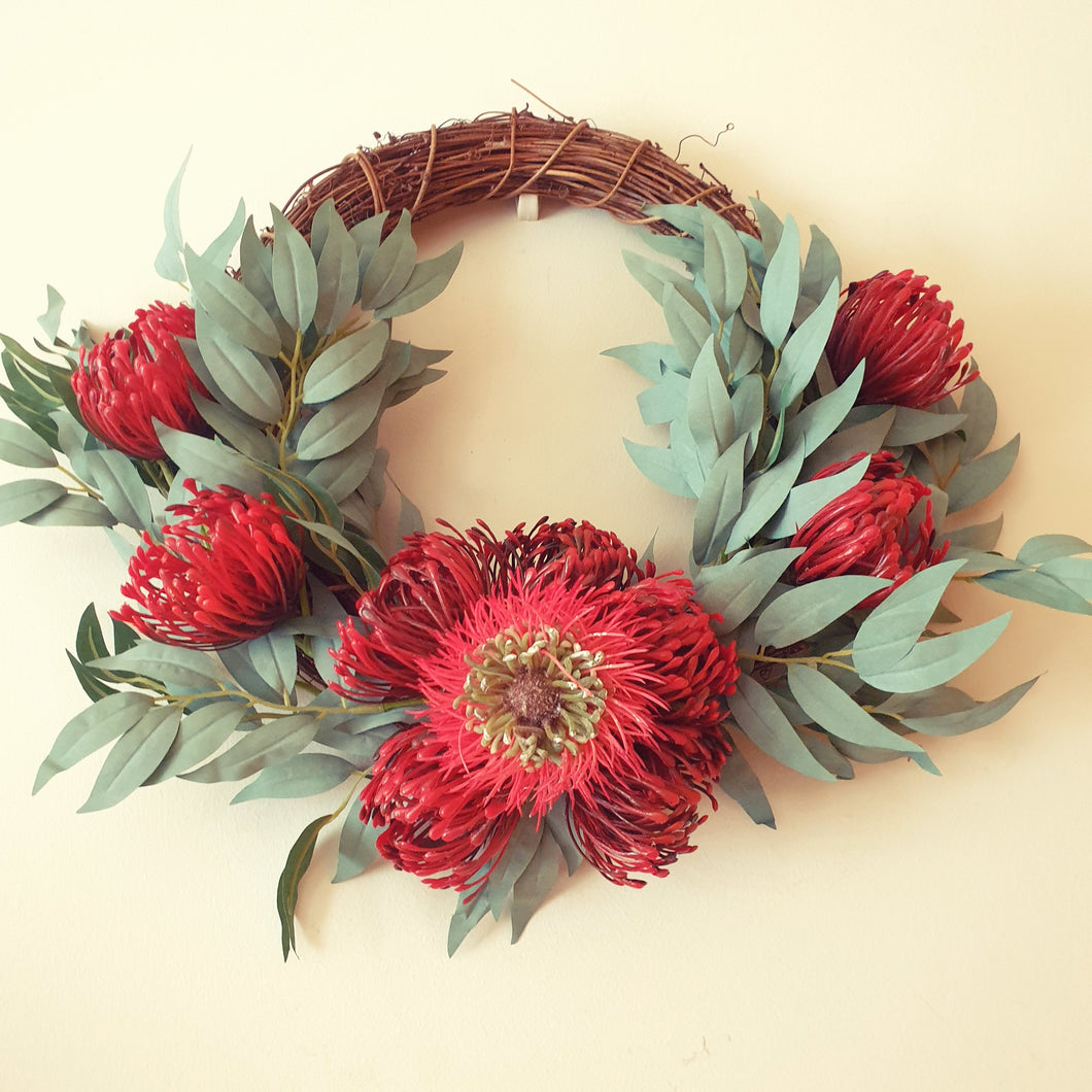 Australian Native Red Banksia, and Red Pincushion protea with gum leaf bush foliage 40cm wreath - FREE DELIVERY