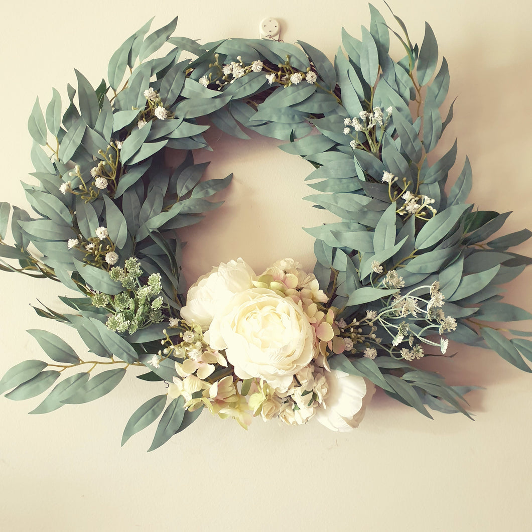 Peonies and Hydrangea with blue gum leaf  foliage on a vine wreath