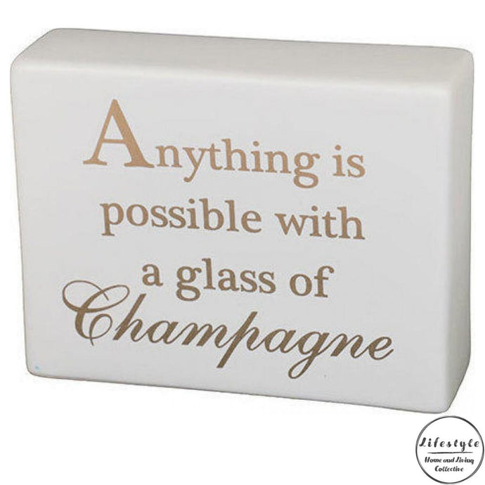Anything is possible with a glass of champagne ceramic table top sign