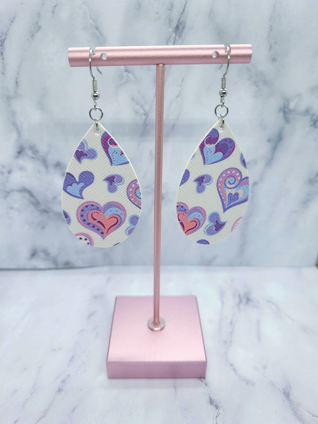 WHITE WITH PURPLE, BLUE, AND PINK HEARTS MAGNOLIA - FAUX LEATHER EARRINGS
