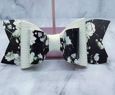 BLACK FLOWER PATTERN AND WHITE FAUX LEATHER BOW