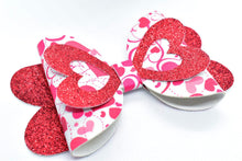 Load image into Gallery viewer, RED SHIMMER AND MOVING HEARTS FAUX LEATHER BOW - Handmade Creations by Liz