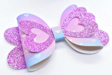 Load image into Gallery viewer, LILAC SHIMMER AND BLUE AND PINK HEARTS FAUX LEATHER BOW - Handmade Creations by Liz