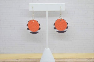 ORANGE WITH BLACK AND WHITE STRIPES FAUX LEATHER EARRINGS - CIRCLE