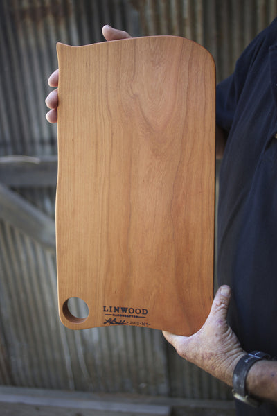 Large handcrafted cherry wooden cutting board for the kitchen. American made gift.