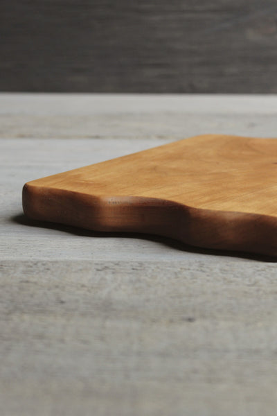 Cherry wood handcrafted cutting board