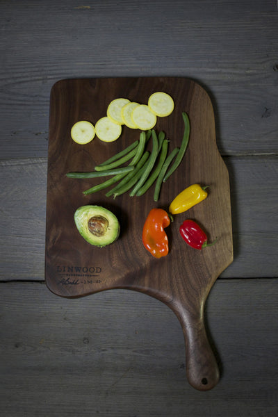 111. Black walnut wooden cutting board with handle. American made gift.