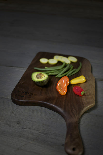 111. Black walnut wooden cutting board with handle