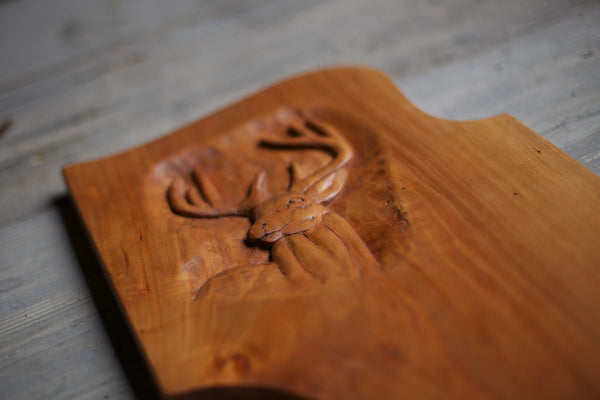 158. Hand carved handmade wooden custom cutting board made out of cherry wood. Carved wooden deer.