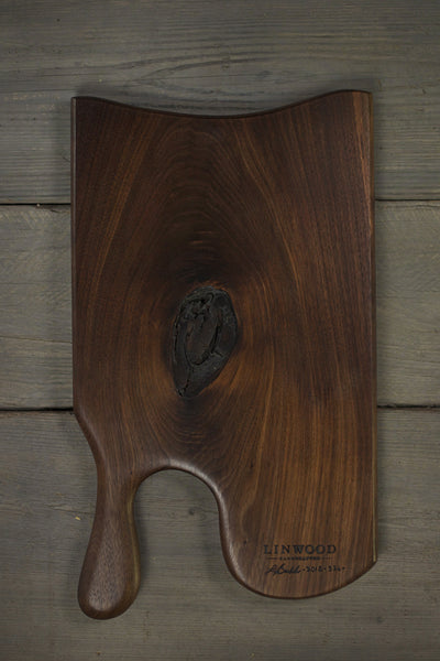 326. Handmade black walnut wood cutting board with handle. Beautiful shiny grain and smooth to the touch. Handcrafted cutting boards for the kitchen.