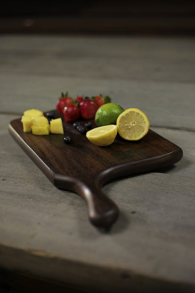 328. Handmade black walnut wood cutting board with a handle - front view 3
