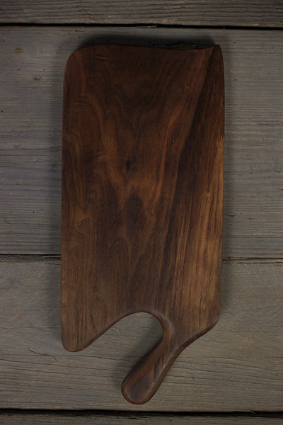346. Handmade black walnut wood cutting board with a handle