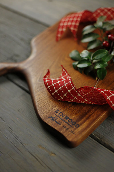 352. Handmade sapele wood cutting board with a handle