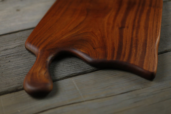 353. Handmade sapele wood cutting board with a handle