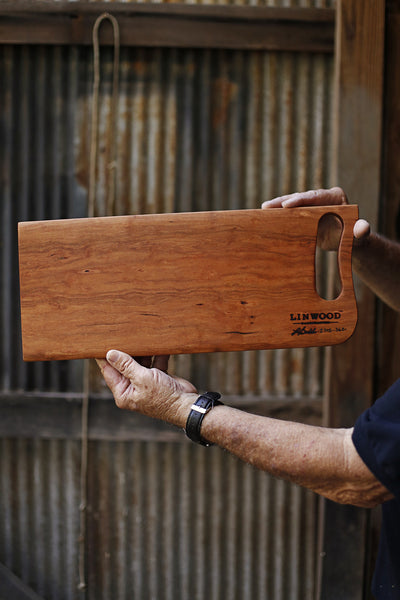 361. Handmade cherry wood cutting board for serving and displaying.