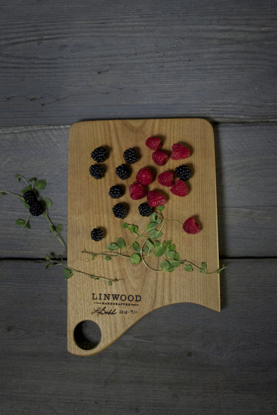 Handmade american made small cherry wood cutting board angle one.