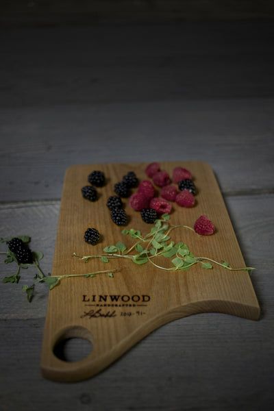 Handmade american made small cherry wood cutting board angle three.