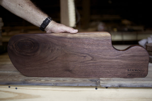 211. Handmade black walnut wooden cutting board with inlay and knots