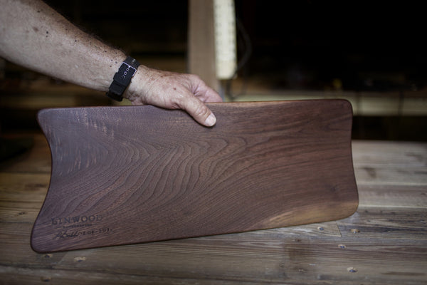 209. Handmade black walnut wood cutting board with inlay and blonde streak.