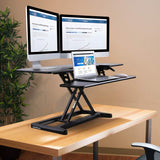 "FLEXISPOT Stand up Desk Converter - 42 inches Wide Platform Standing Desk Computer Riser with Deep Keyboard Tray for Laptop (42"", Black, M7L)"