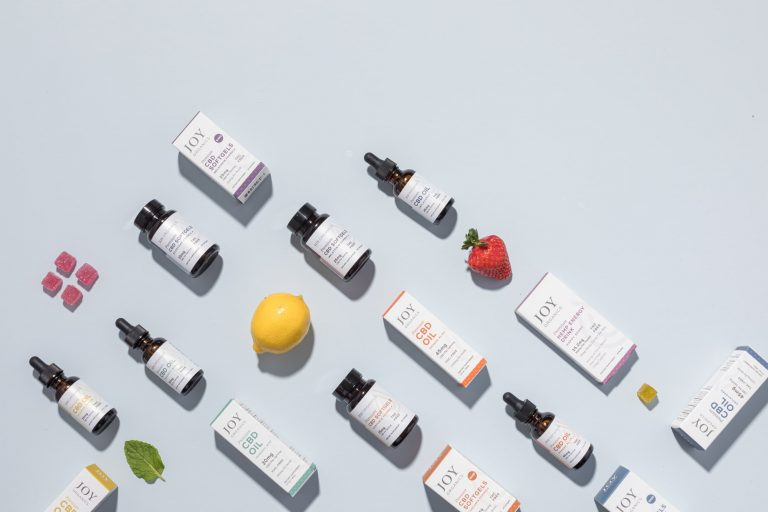assorted Joy Organics products and fruit