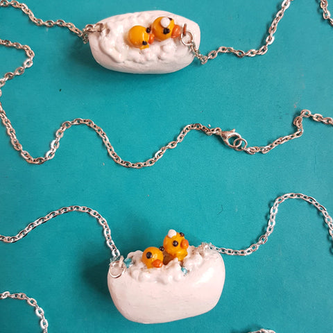 Rubber ducks in a bubble bath necklace