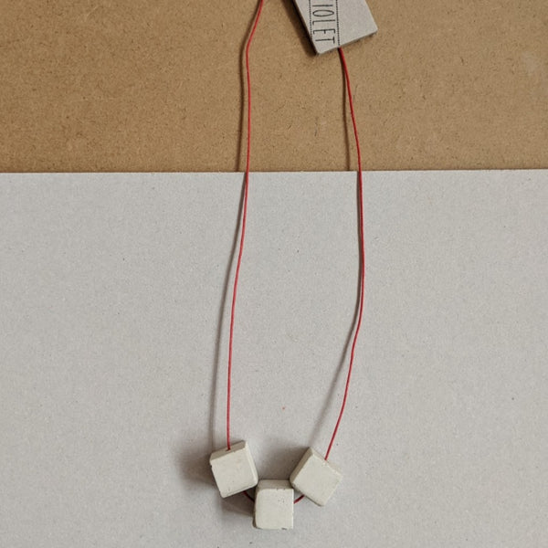 Concrete square trio necklace on red waxed cord