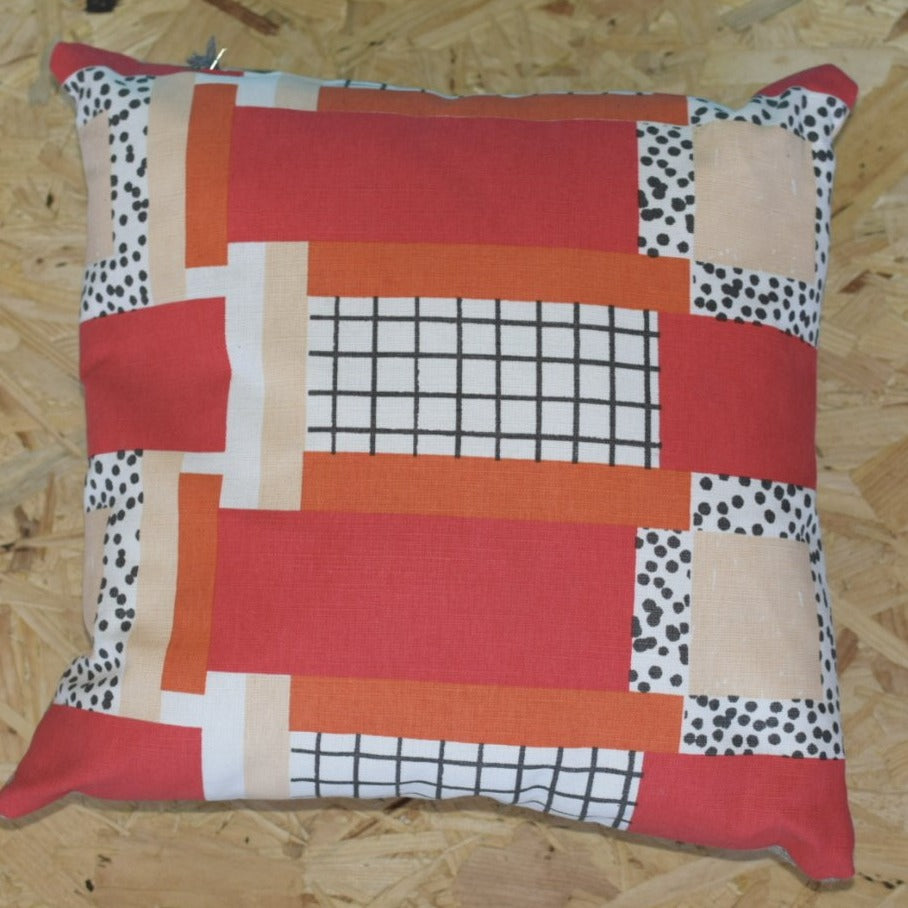 Grid and polka dot hand stitched pillow