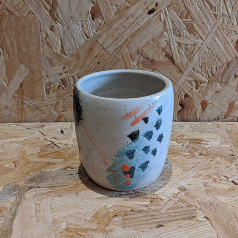 Patterned ceramic coffee cup