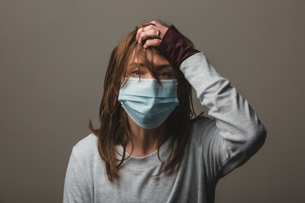 Woman in disposable mask