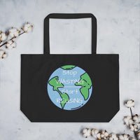 "Front of the Large Black Tote Bag lying on a gray granite table.   On it is an image of the world with the words ""Stop Wasting, Start Reusing"" in the middle of the world.  Above & below the tote bag are flowers."