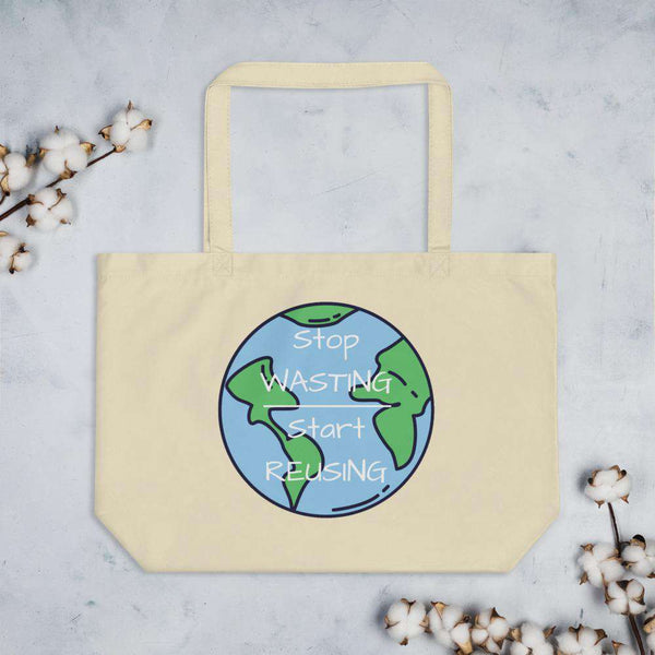 "Front of the Large Oyster Tote Bag lying on a grey granite table.   On it is an image of the world with the words ""Stop Wasting, Start Reusing"" in the middle of the world.  Above & below the tote bag are flowers."