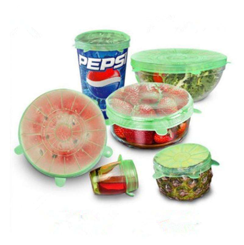 6 piece set of the green Silicone Food Covers each on something different.  Some of those things include a cup of soda, a watermelon, a cup of juice, a bowl of strawberries, a half of a pineapple, & a bowl of salad.