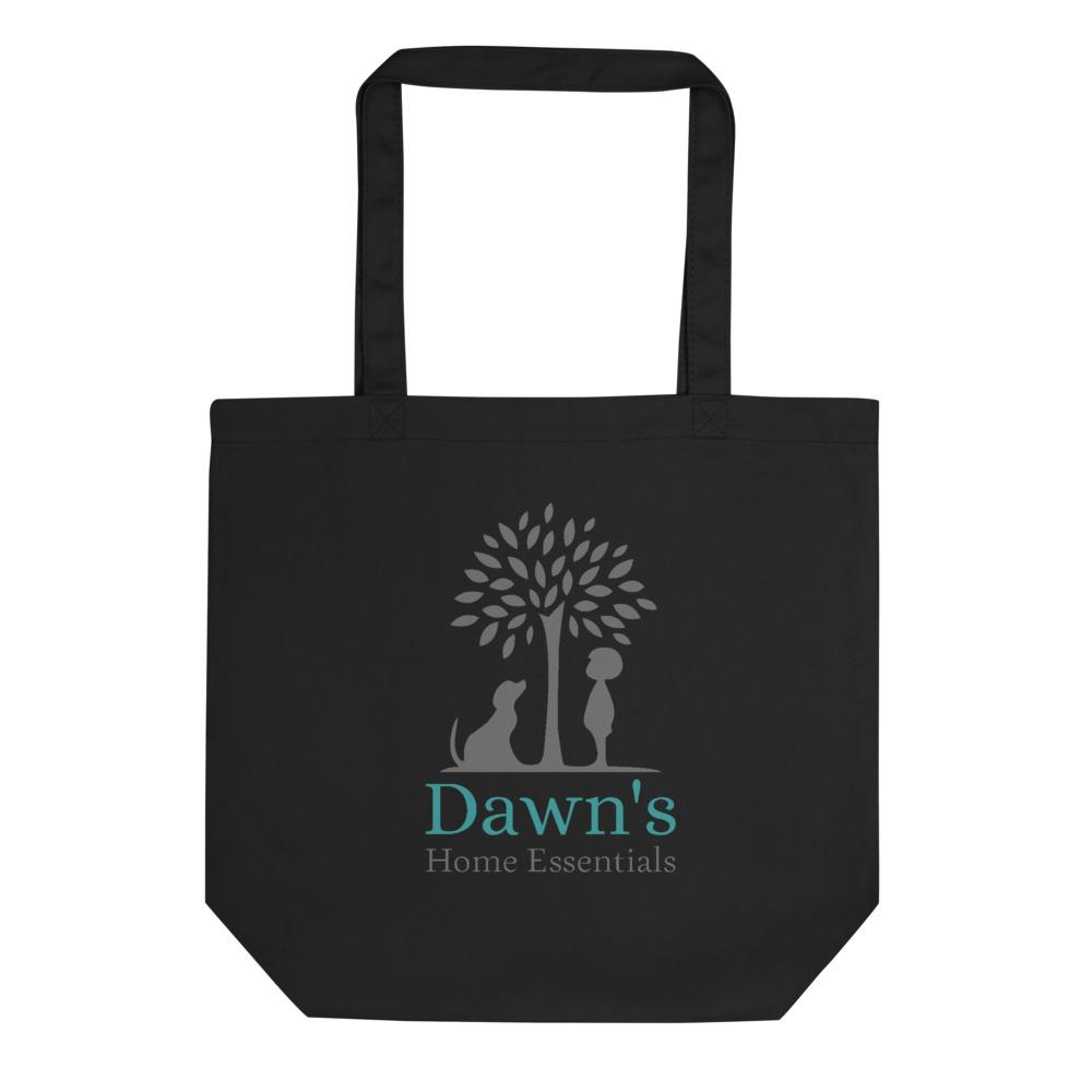Back of the Small Black Tote Bag on a white background.   On it is an image of Dawn's Home Essentials Logo;  A tree with a dog sitting and a child standing, one on each side, both looking up at the tree.  Under the tree says Dawn's in teal and Home Essentials in gray.