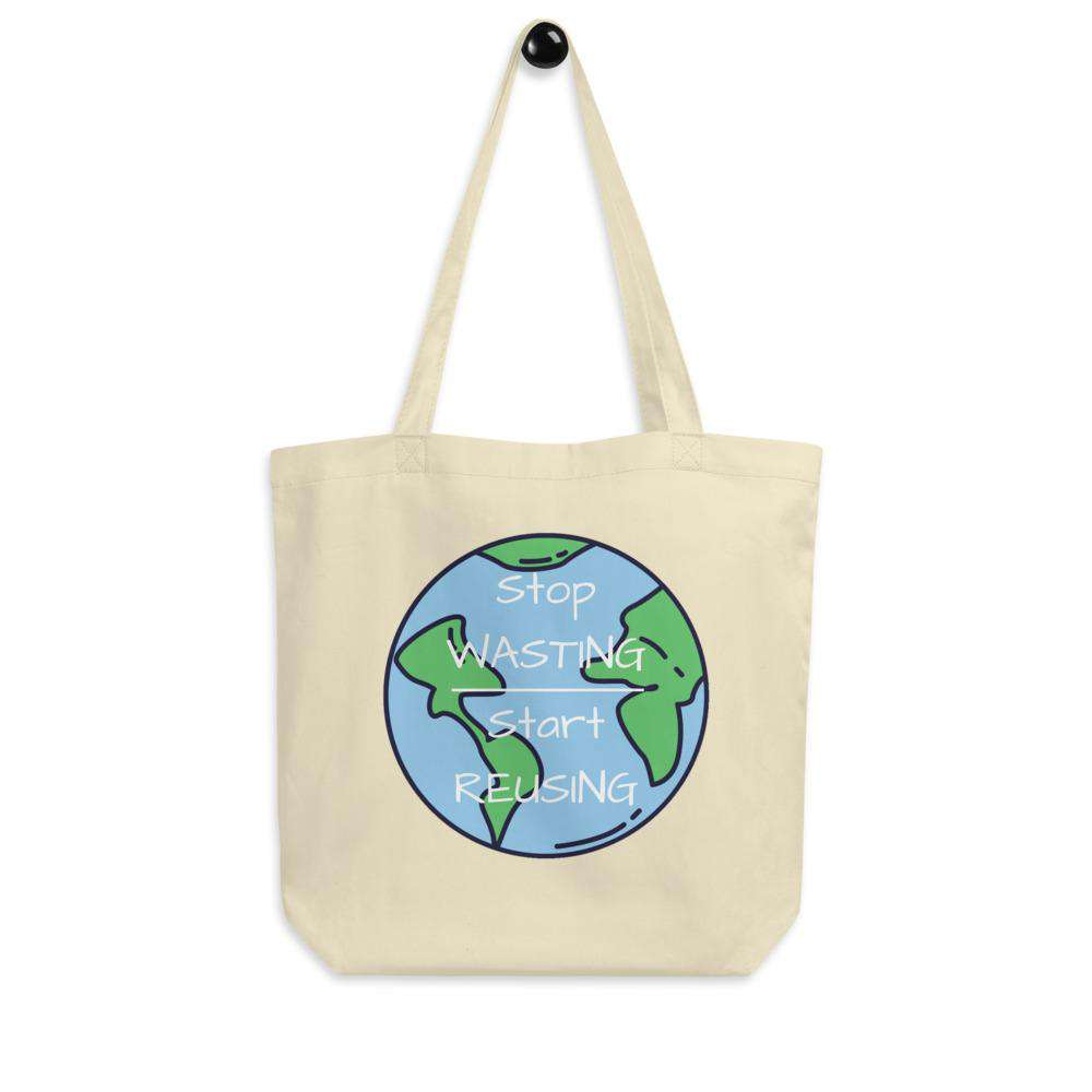 "Oyster Stop Wasting, Start Reusing Tote Bag hanging on a white wall.  It is showing the front side of the bag which has an image of the world and the words ""Stop Wasting, Start Reusing"" in the middle of the world."