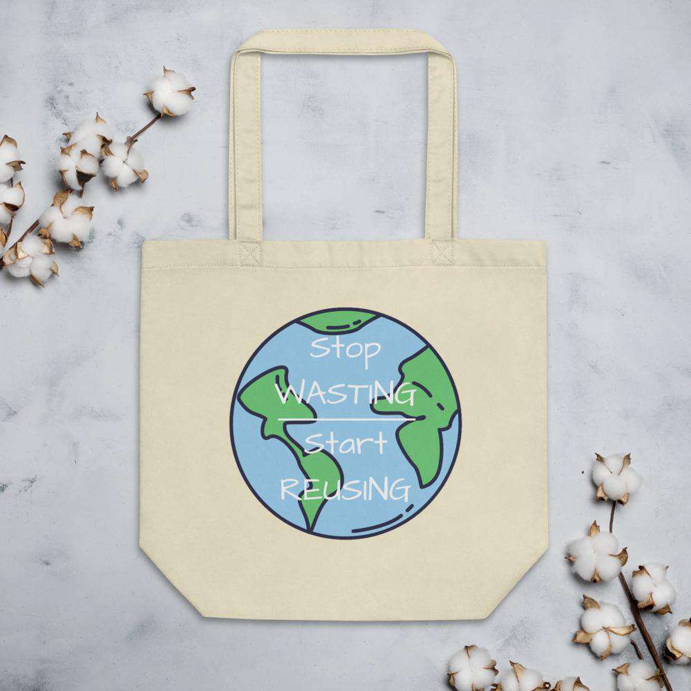"Front of the Small Oyster Tote Bag lying on a gray granite table.   On it is an image of the world with the words ""Stop Wasting, Start Reusing"" in the middle of the world.  Above & below the tote bag are flowers."
