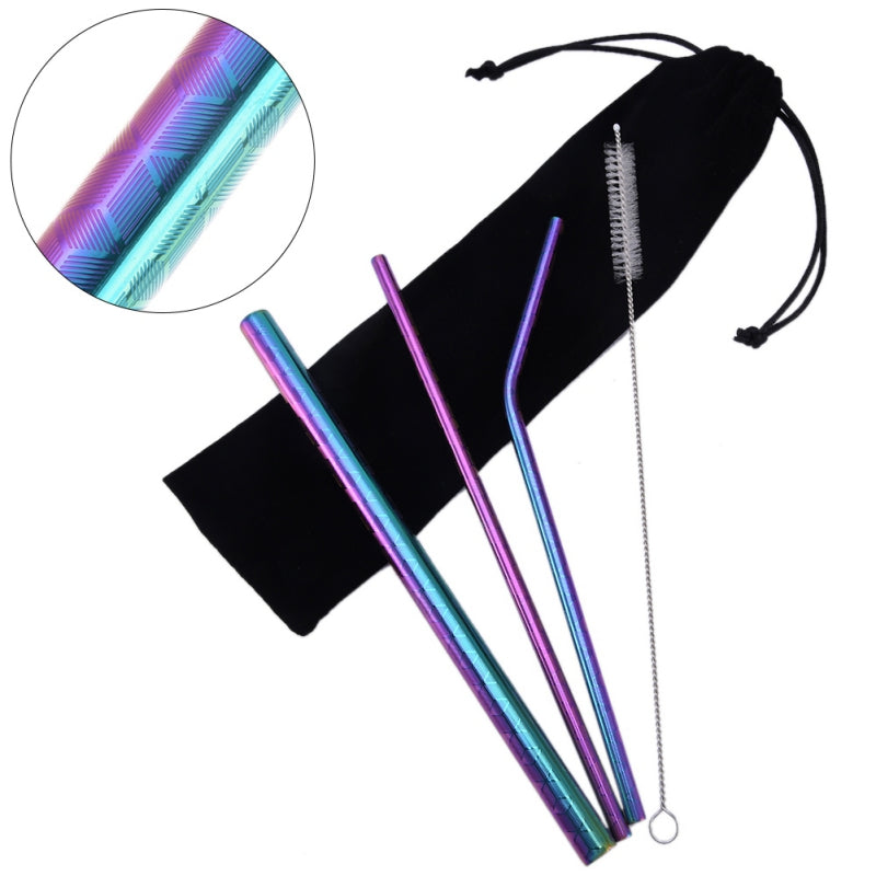 Multi-Colored Stainless Steel Straw Set lying on top of a carrying bag.  Left to right; thick straw, thin straw, curved straw, & a cleaning brush.