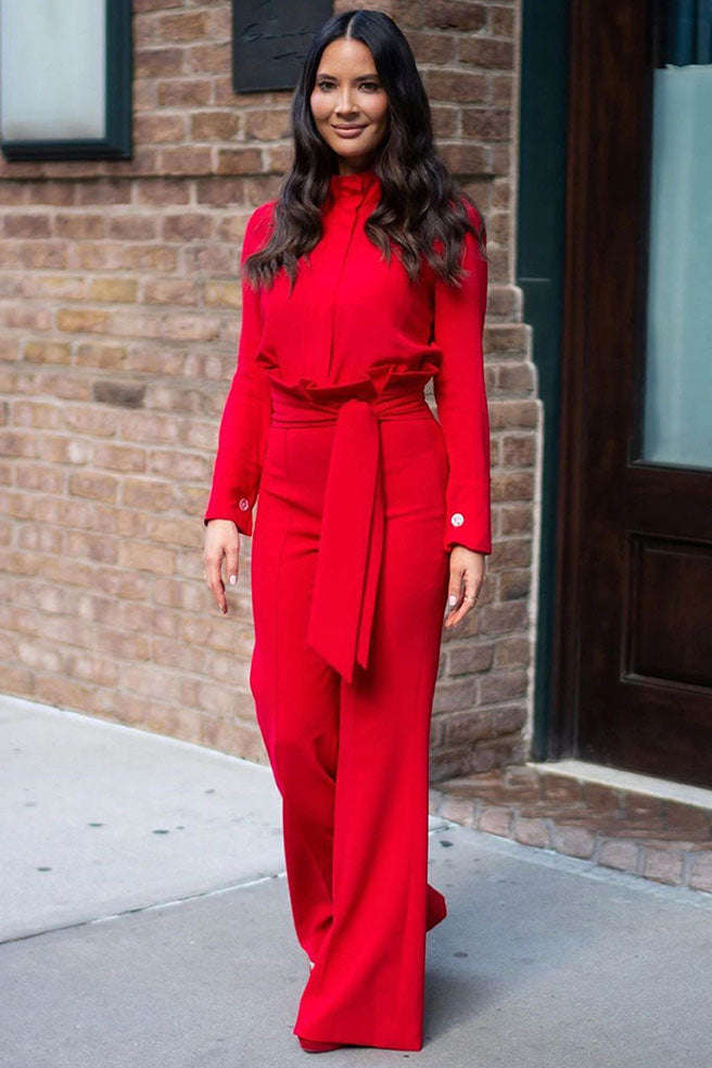 Olivia Munn wearing signature blouse in red