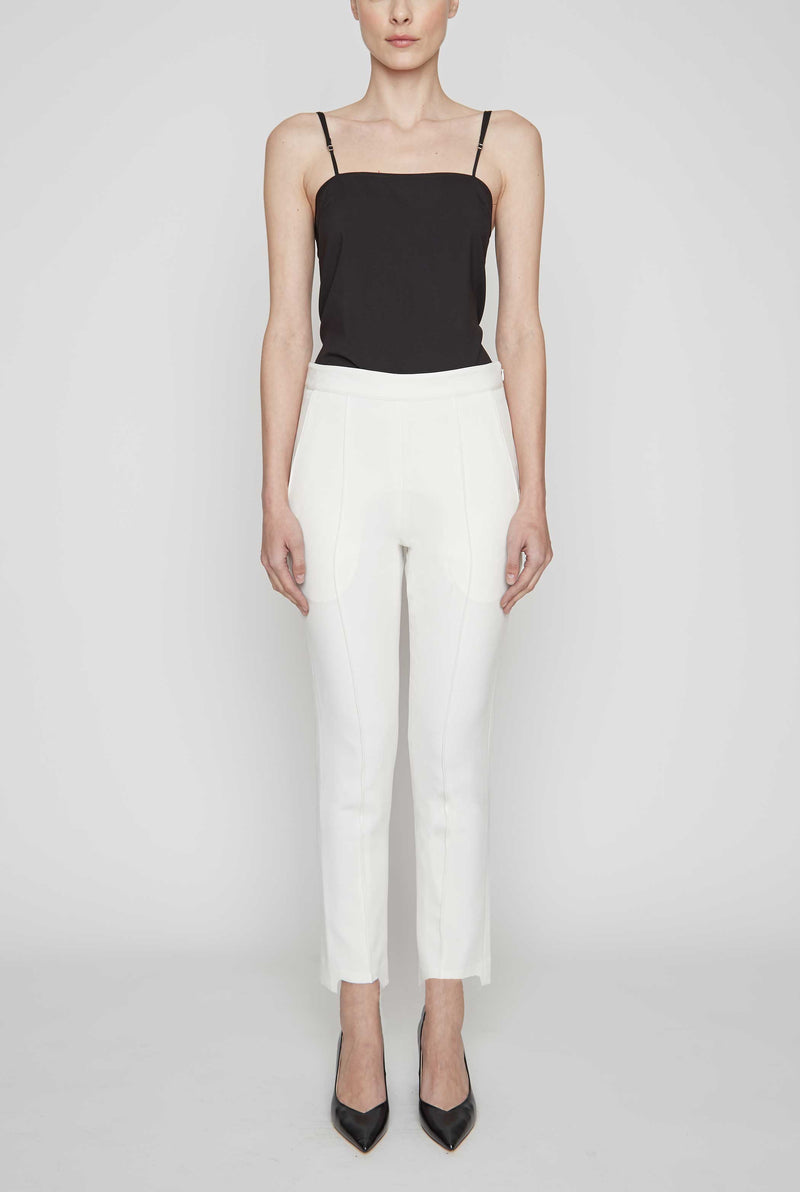 We create designer fashion that remains relevant and never chases a trend, with lasting styles of quality and value.  This Cropped Tuxedo Pant is made from stretch cotton and is our most comfortable pant.  It features stylish detailing in its step-up, raw edge, cropped hem. Try on in the comfort of your own home with free shipping and free returns.