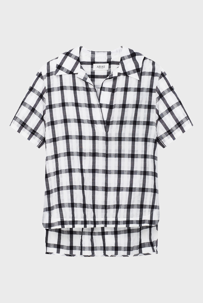 ARIAS' collections fall in that sweet spot between statement and classic and include the clothes we often need to reach for on a daily basis. Made from an airy cotton-voile Italian fabric, this Checked Tunic Top showcases an artful, curved high-low hem and impeccable fit.