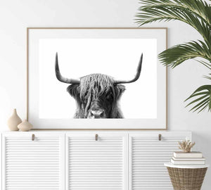 Make a statement in your decor with our simple scandi cow art print.