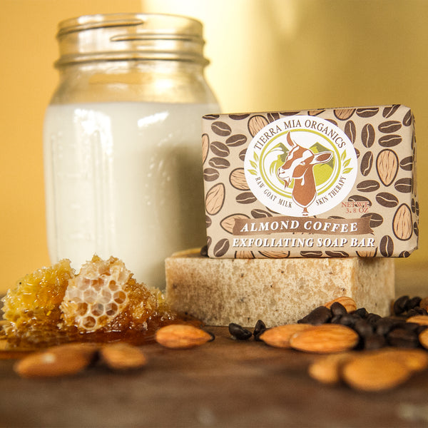 milk jar with honey comb and almonds and soap bar
