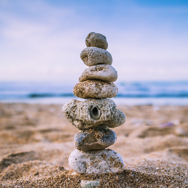 small rocks stacked on beach