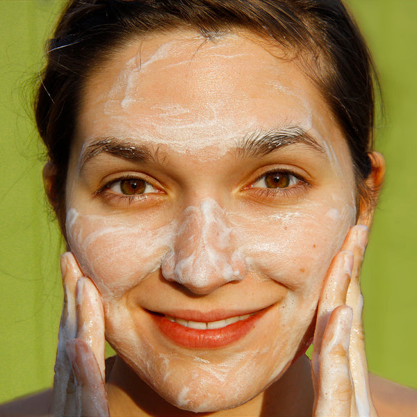 woman with soap suds on face